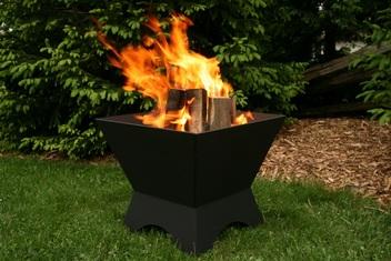 Modern Cube Fire Pit Black in a Back Yard