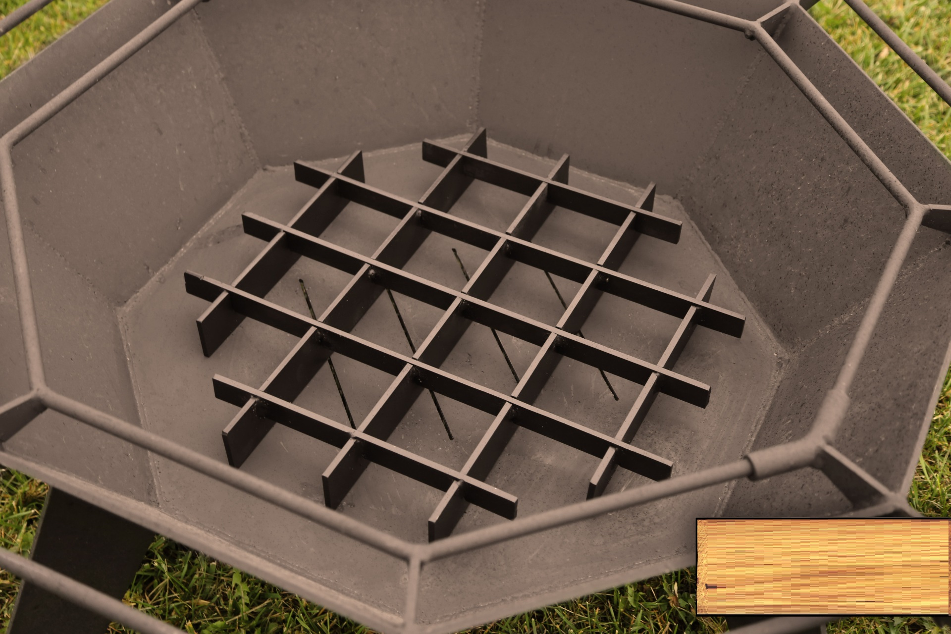 octagonal fire grate in a fire pit outside in the backyard